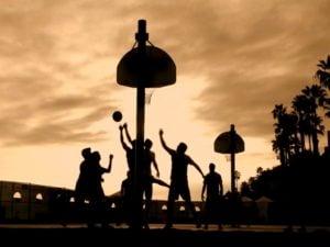 People Playing Basketball at Sunset
