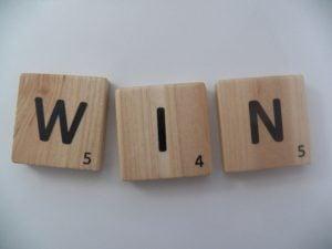 Scrabble Tiles Spelling Out WIN